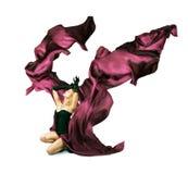 有紫色丝绸的妇女在白色背景 图库摄影