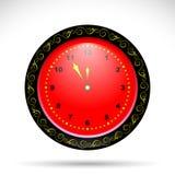 有黄色卷曲装饰品的红色时钟 免版税图库摄影