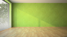 有绿色墙壁和木条地板的空的室 免版税库存照片