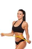 有黄色措施的美好的运动的妇女身体 库存照片