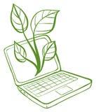 有绿色植物的图象的一台绿色膝上型计算机 免版税库存照片