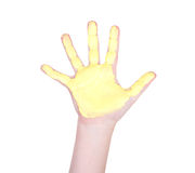 有黄色油漆的Childs手对此 免版税图库摄影
