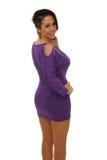 有紫色礼服的性感的妇女 免版税库存照片