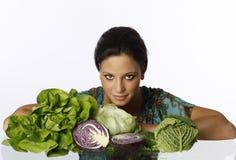 有绿色菜的少妇 免版税库存照片
