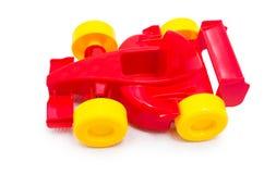 有黄色轮子的塑料红色赛跑的玩具汽车玩具 库存图片