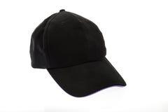 有紫色颜色修剪的黑高尔夫球帽在白色背景 免版税库存图片