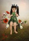 有蝴蝶的小女孩 库存照片