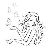 有蝴蝶的美丽的妇女在她附近 免版税库存照片