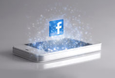 有3d Facebook象的智能手机 免版税库存图片