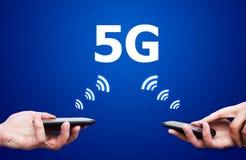 有5G网络通信的移动设备 免版税库存照片