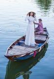有Ao戴礼服的越南妇女 免版税库存照片