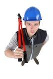 有boltcutters的建筑工人 免版税图库摄影