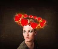 有circleing在她的头附近的心脏例证的少年女孩 免版税库存照片