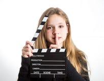 有clapperboard的十几岁的女孩 库存图片