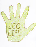 有eco生活标志的绿色图画手 库存图片