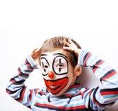 有facepaint的小逗人喜爱的男孩喜欢小丑,哑剧表示 免版税图库摄影