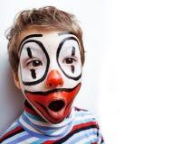 有facepaint的小逗人喜爱的真正的男孩喜欢小丑,哑剧expre 免版税库存照片
