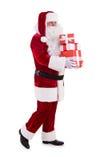 有giftboxes的愉快的圣诞老人 免版税库存照片