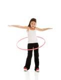 有hula箍的愉快的女孩 库存图片