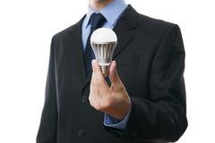 有LED电灯泡的商人 免版税库存照片