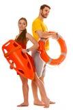 有lifebuoy抢救和的救生圈的救生员 免版税库存照片