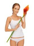 有lilly水芋属的可爱的妇女 库存图片
