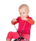 有phonendoscope的小婴孩坐白色背景 免版税库存照片