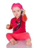 有phonendoscope的小婴孩坐白色背景 库存照片