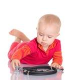 有phonendoscope的小婴孩坐白色背景 免版税库存图片