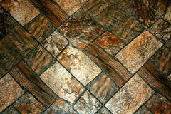 有rectangel石头的装饰墙壁 布朗纹理 免版税库存图片