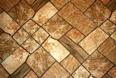 有rectangel石头的装饰墙壁 布朗纹理 库存图片