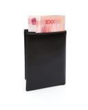 有RMB 100纸币的钱包与裁减路线 免版税库存图片
