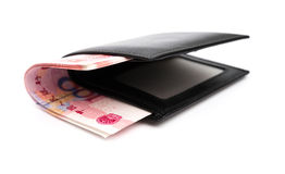 有RMB 100纸币裁减路线的钱包 免版税库存图片