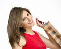 有shoping的袋子的可爱的女孩 库存照片