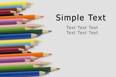 有simlple文本的颜色铅笔 免版税库存图片