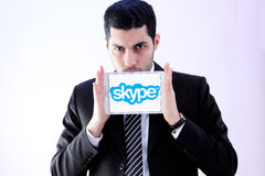 有skype的阿拉伯商人 库存图片