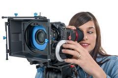 有SLR摄象机的美丽的少妇 库存照片
