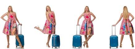有suitacases的妇女为暑假做准备 免版税库存照片