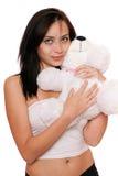 有teddybear的梦想的逗人喜爱的女孩 免版税图库摄影