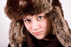 有ushanka的逗人喜爱的蓝眼睛的女孩 免版税库存照片