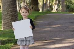 有whiteboard的小女孩 库存图片