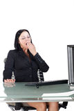 服务台打呵欠的办公室工作者 免版税图库摄影