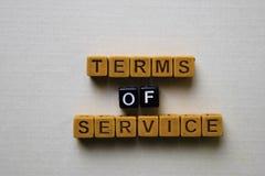 服务条款在木块的 企业和启发概念 图库摄影