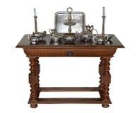 服务的古色古香的桌与银器 免版税库存照片