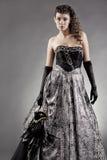 服装化妆舞会佩带的妇女 免版税库存图片