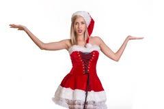 服装的圣诞老人妇女玩杂耍某事的 免版税图库摄影