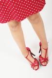 服装红色害羞的妇女 库存照片