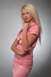 服装魅力粉红色妇女年轻人 库存图片