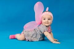 服装蝴蝶的小婴孩 库存照片