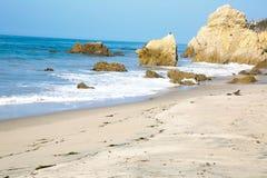晴朗海滩的日 免版税库存图片